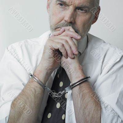 Thinking man with cuffs