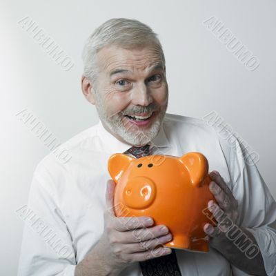 Happy man with piggy bank