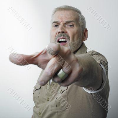 Matur man pointing finger