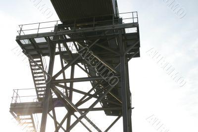 Sunshine Through Steps of Industrial Conveyor
