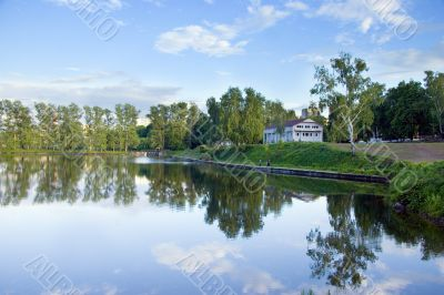 Blue square pond with reflections, summer, Moscow