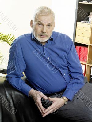 Executive seated on sofa