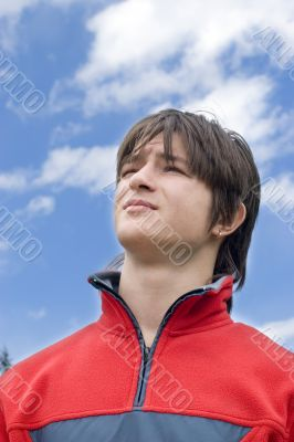Boy teens looking to blue skies, outdoors