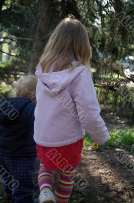 two small kids taking a walk