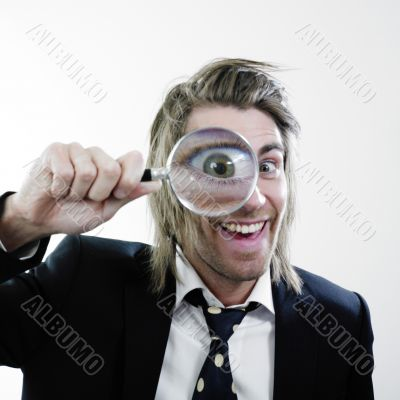 Happy man with magnifying lens