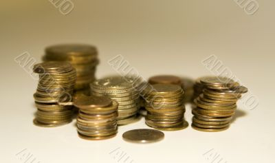 Coins on a white-gold background