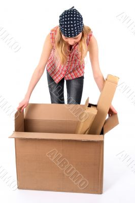 Young woman looking into an open box