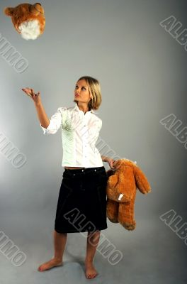 Young woman playing with the teddy bear