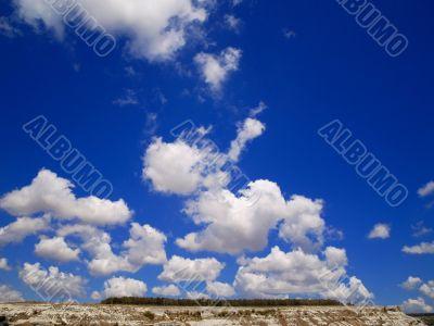 white clouds blue  sky sun