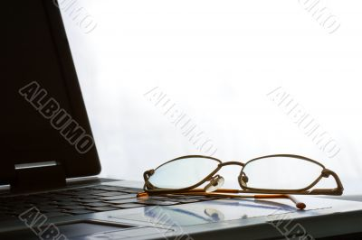 laptop with laying glasses