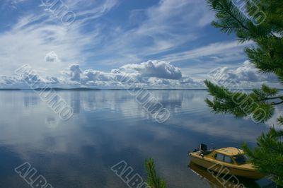 Boat on lake shore
