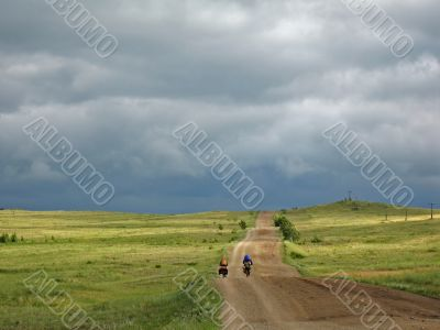 Couple of cyclists go to road. Bike Touring.