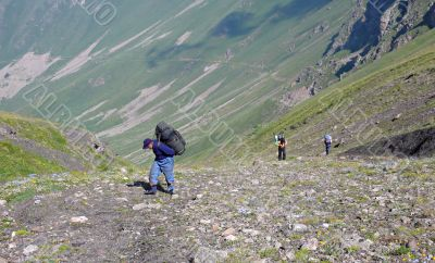 Three people making their descent up