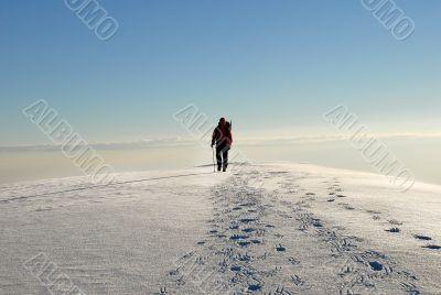 One man climber trekking  on a mountain