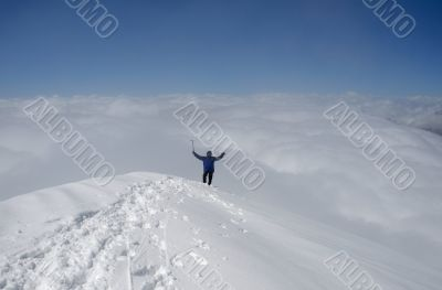 Climber standing on top of mountain