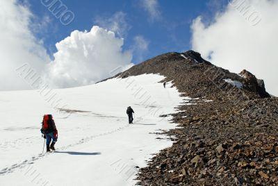 Three men trekking  on a mountain