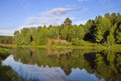 Blue reflection in lake at summer forest