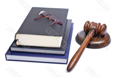 Wooden gavel, glasses and law books