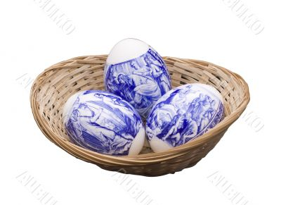 Easter eggs in a basket on the isolated white background