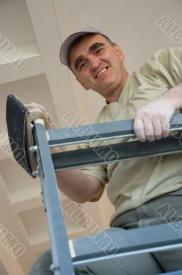 builder on a ladder