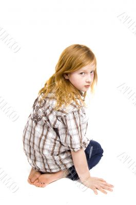 little girl watching over her shoulder