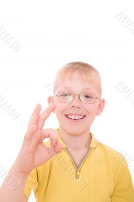 Smiling teenager showing OK sign.