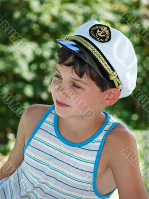 Boy in captain`s peak-cap