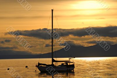 Yacht and sunrise in port of  Ushuaia,  Argentina.