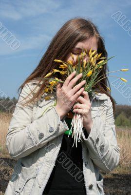 girl smell flowers