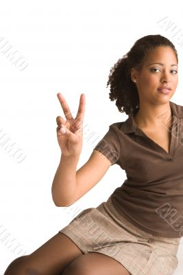 African girl gives a peace sign