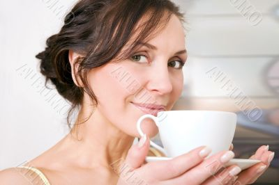 young woman enjoying a cup of tea