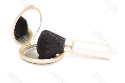 Brush for makeup reflected in mirror