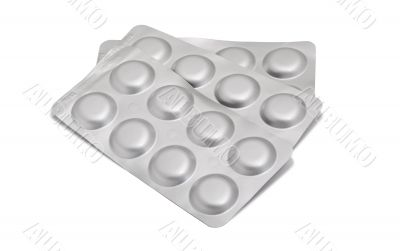 pills in a gray blister pack, isolated on white