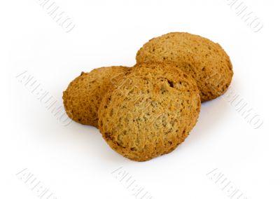Three oatmeal cookies with raisins