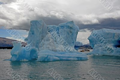 Iceberg in lake Argentino and ship