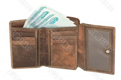 brown leather wallet with some bank notes