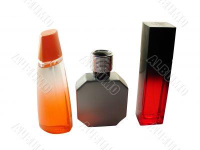 three perfume vials