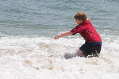 Boy Playing in the Ocean