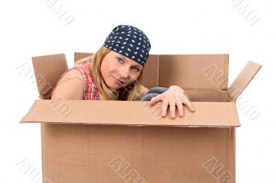 Girl hiding in a cardboard box
