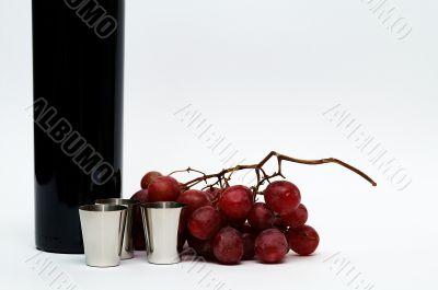 Cups, grapes, vine still life