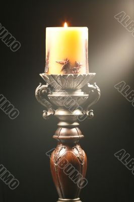 Antique wooden candlestick with ray of light