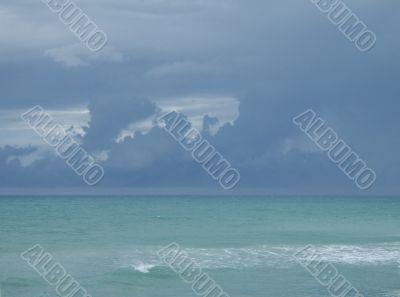 dark blue sky over turquoise ocean