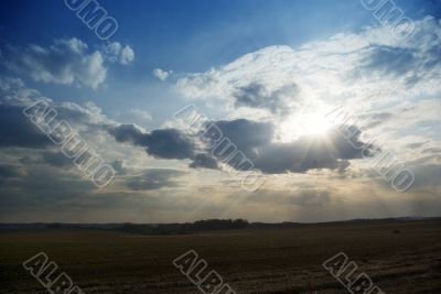 evening landscape with ray calling at sun