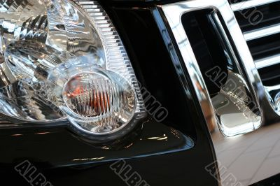 detail of new car in dealership showroom