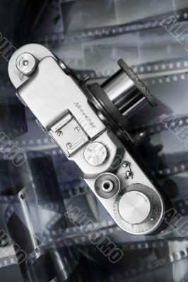 Vintage rangefinder camera from top over black and white film