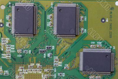 Close-up on a microchip on a scheme background