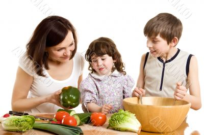 mother and children cooking at the kitchen