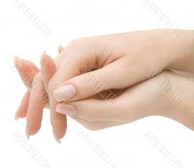 Woman hands with crossed fingers isolated with clipping path