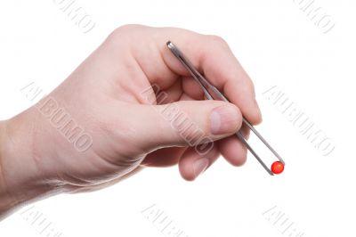 Hand, pincers, pill