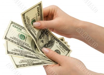 US Dollars in woman`s hand, isolated with clipping path